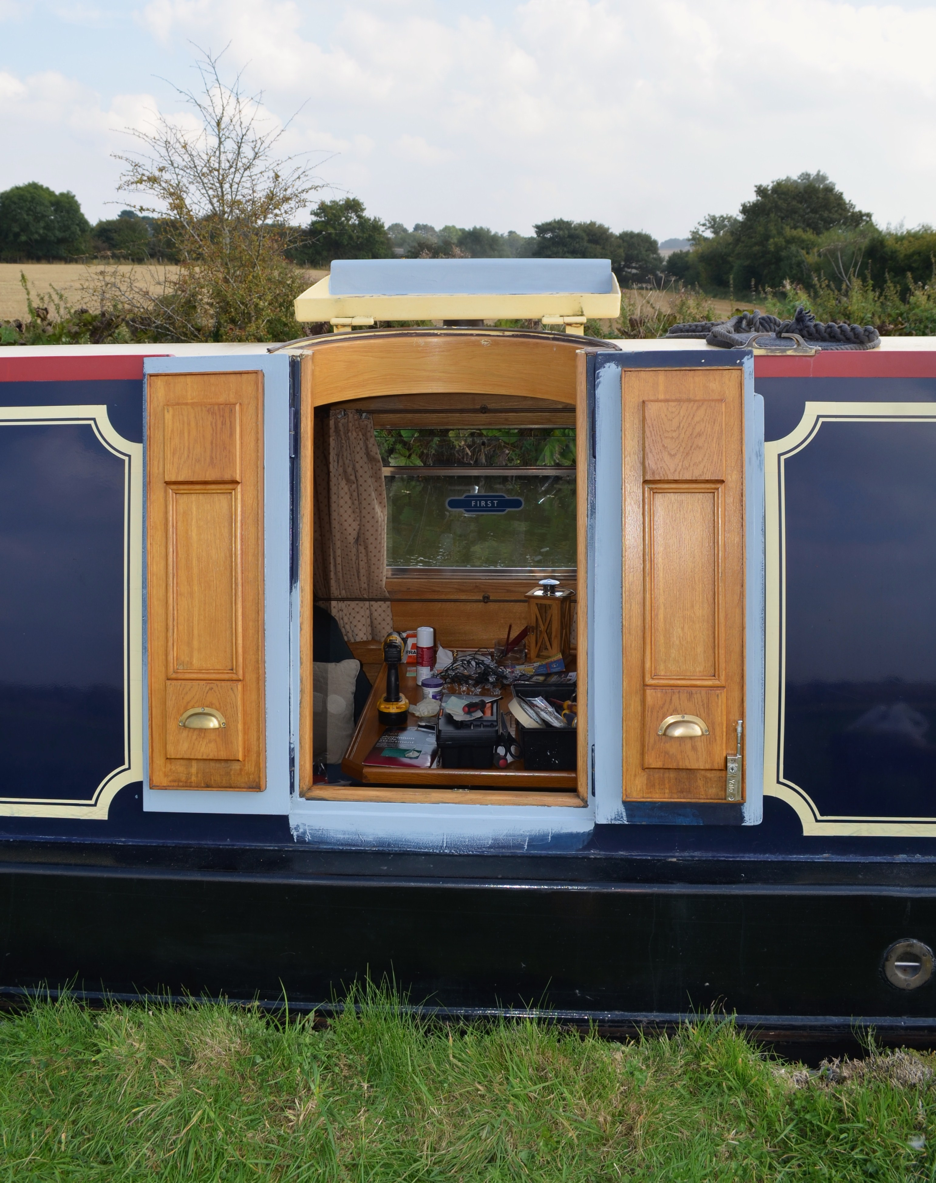 assed on by watching us turn the boat inside out yet again. The combination of decent weather and a quiet towpath keeps proving too much to resist. & narrowboat side hatch | Marpessa2